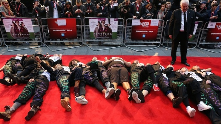 Suffragette premiere Interrupted by protesters opposing Tory cuts to vital public services for women
